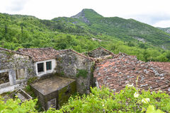 The Godinje village at Montenegro. The ruined and abandoned house in the Godinje village at Montenegro Royalty Free Stock Photos