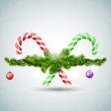 Godis för glad jul med granfilialer Arkivfoto