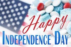 Godisar med amerikanska flaggan på självständighetsdagen Fotografering för Bildbyråer
