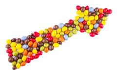 Godisen färgade glasyr i formen av pilen Arkivbild