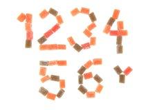 godisfrukt skära i tärningar alfabet Arkivbild