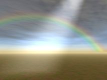 Godrays and Rainbow. Storm and Rainbow over empty field, with ligh rays Royalty Free Stock Photo