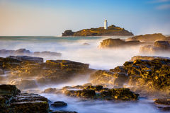 Godrevy Lighthouse, Cornwall. United Kingdom. Green sea with blue sky, misty water and long exposure, rocks, island Royalty Free Stock Image