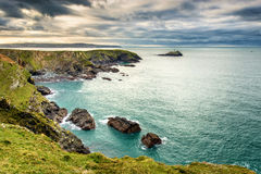 Godrevy Lighthouse, Cornwall. United Kingdom. Green sea, moody skies, green grass Stock Photo