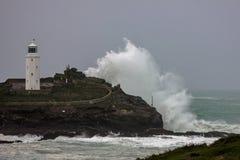 Godrevy - weathering the storm. Storm waves batter cornish coast Royalty Free Stock Photography