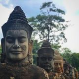 The gods face at the Southern Gate of Angkor Thom stock image
