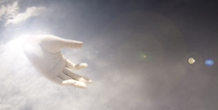 Gods Hand. A conceptual background of a 'Gods Hand' coming out from a cloudy sky Stock Photography