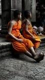 Godsdienstige ankor wat munks Sinaasappel van Kambodja Stock Foto