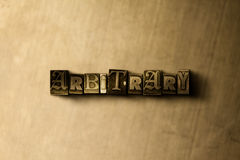 GODTYCKLIGT - närbild av det typsatta ordet för grungy tappning på metallbakgrunden Royaltyfri Foto