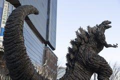 Godzilla statue in Hibiya. January 21, 2019, Tokyo, Japan - A Godzilla statue is seen in front of Hibiya Chanter shopping mall in Yurakucho district stock image