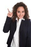 Goed idee: geïsoleerde jonge bedrijfsvrouw in blauw met wijsvinger Stock Afbeeldingen