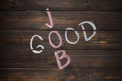 Goede die Baanwoorden op houten raad over geweven muur worden geschreven stock afbeelding