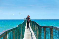 She goes down the pier. Royalty Free Stock Photos