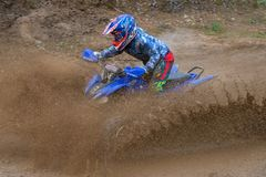 Goes Through the mud. SERPUKHOV, RUSSIA - OCTOBER 7, 2017: Nikolaev Maksim 13,  Class ATV-JUNIORS, in the 4 stage  MX series, the Red Wings Cup 2017 super Royalty Free Stock Photo