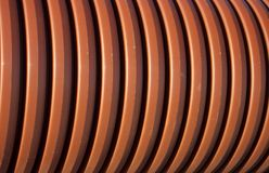 Goffered pipe close-up. The orange  goffered pipe close-up Stock Photography