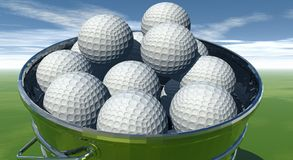 Gofl balls in bucket. Golf balls in a bucket Royalty Free Stock Images
