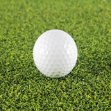 Goft ball on green grass Royalty Free Stock Photo