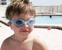 Goggle boy. A little boy in googles at poolside stock image