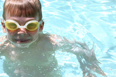 Goggle Eyes. Boy in pool wearing goggles Stock Photos