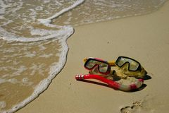Goggles. 2 pairs of goggles on the beach Stock Photography