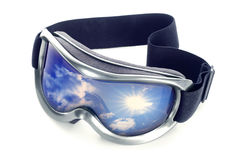 Goggles. Sun-goggles on a white background. In glass sky reflexion Stock Photos