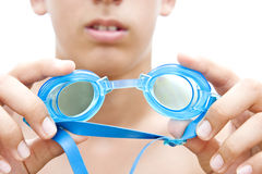 Goggles. A boy is holding goggles in his hands stock image