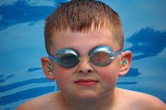 Goggles. Young boy swimming with goggles and ear plugs Stock Image