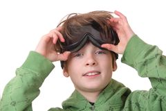 Goggles. Portrait of a young boy wearing ski goggles isolated on white background Royalty Free Stock Photos