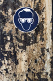 Goggles. Mandatory goggles construction industry sign mounted on Rusty Metal Royalty Free Stock Image