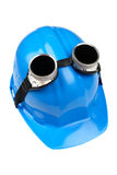 Goggles and blue hard-hat Royalty Free Stock Photography