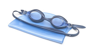 Goggles and cap for swimming. Blue swimming cap and goggles royalty free stock image