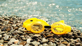 Goggles for diving on the seaside Stock Photography