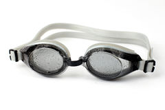 Goggles for diving  in water droplets on white background Royalty Free Stock Image