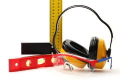 Goggles and earphones Stock Photos