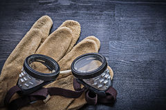 Goggles on gloves and wood board Royalty Free Stock Images