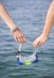 Goggles in hand Royalty Free Stock Images