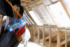 Goggles hanging from tool belt in attic royalty free stock photo