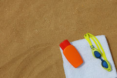 Goggles and sunblock on beachtowel. A photo of Goggles and sunblock on beachtowel Royalty Free Stock Photography