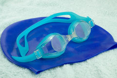 Goggles and Swimming cap Royalty Free Stock Images