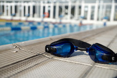 Goggles for swimming on a pool side Stock Images