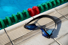 Goggles for swimming on a pool side Stock Image
