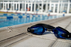 Goggles for swimming on a pool side Stock Photography