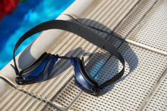 Goggles for swimming on a pool side Royalty Free Stock Image