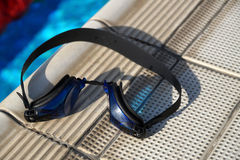 Goggles for swimming on a pool side Royalty Free Stock Photos