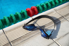 Goggles for swimming on a pool side Royalty Free Stock Photo