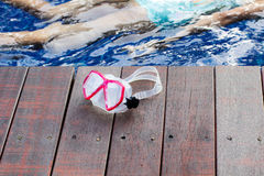 Goggles on the wood poolside Stock Photography