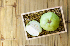 Goiaba on wooden box Royalty Free Stock Images