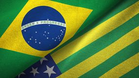 Goias state and Brazil flags textile cloth, fabric texture. Goias state and Brazil folded flags together stock illustration