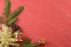 Goil foil bow and fir branch red background Royalty Free Stock Photo