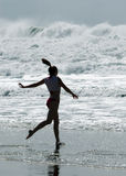 Going in. Girl running into ocean Royalty Free Stock Photo